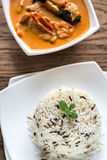 Thai panang curry with bowl of white and wild rice royalty free stock photo