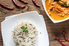 Thai panang curry with bowl of white and wild rice Royalty Free Stock Photography