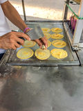 Thai pancakes Buy it by shopping cart. Children always like it. Because it is easy to find cheap and delicious Stock Images