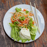 Thai papaya salad also known as Som Tam from Thailand. Stock Photos