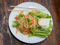Thai papaya salad also known as Som Tam from Thailand. Vegetarian Thai papaya salad also known as Som Tam from Thailand . Close up Stock Photo