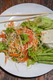 Thai papaya salad also known as Som Tam from Thailand. Stock Photo