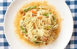 Thai papaya salad on blue fabric Royalty Free Stock Photos