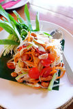 Thai papaya salad. A photograph showing Som Tam, or Som Tum, the popular salad vegetable dish of Thailand, southeast asia. Made with green papaya cut into thin stock image