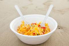 Thai papaya salad serve. At the beach royalty free stock photography