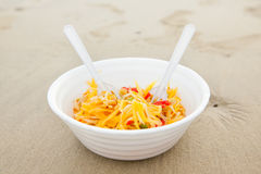 Thai papaya salad serve. At the beach royalty free stock photos