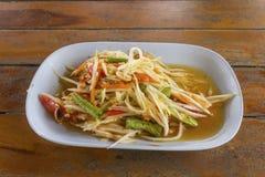 Thai papaya salad. Serve on wood background Royalty Free Stock Photography