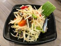 Thai papaya salad or Som Tom. On the plate stock photo