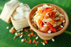 Thai Papaya Salad. Som-Tum, Thai Papaya Salad is one of the most famous Thai food. Main ingredients are raw papaya, dried shrimps, chilli peppers, peanuts, lime Stock Images