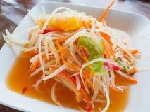 Thai papaya salad Som tum Thai. On wood table stock images