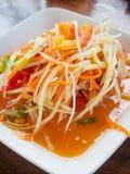 Thai papaya salad Som tum Thai. On wood table royalty free stock photos