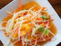Thai papaya salad Som tum Thai. On wood table royalty free stock images