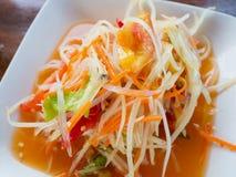 Thai papaya salad Som tum Thai. On wood table royalty free stock photography