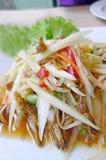 Thai papaya salad (Som Tum). On white plate stock photography