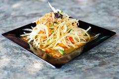 Thai Papaya Salad. Som tum Thai on wood table Stock Image
