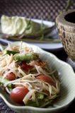 Thai papaya salad Somtam. Thai traditional food Somtam and mortar Royalty Free Stock Photo