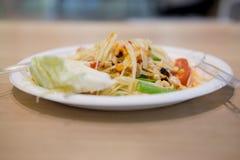 Thai papaya salad Somtum. On wood table Royalty Free Stock Photo