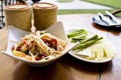 Thai papaya salad and sticky rice. Thai papaya salad call som-tam and sticky rice in dining table Royalty Free Stock Image