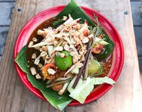 Thai papaya spicy salad. Papaya spicy salad on banana leaf in Thailand royalty free stock images