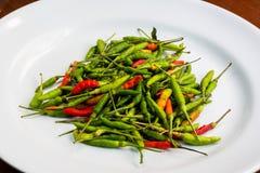 Thai paprika on white dish. On the table Stock Photos