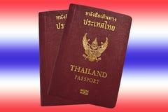 Thai passport. On Thai flag background stock photos
