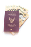 Thai passport with Korea Won currency bank notes Royalty Free Stock Photos