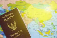 Thai passport lay on asia map. Thai passport lay on asia paper map stock images