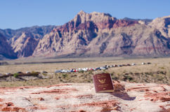 Thai passport with red rock canyon background. Thai passport on red rock canyon background Stock Photos