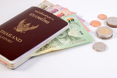 Thai Passport with Thai money banknote and Thai coin isolated on white. Stock Photography