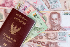 Thai Passport with Thai money banknote on Thai money background. Royalty Free Stock Images