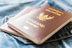 Thai passport. Thailand passport on jeans, Ready to travel around the world Stock Image