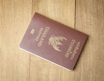 Thai passport on wood background. Photo stock images