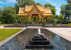 A Thai Pavilion. A beautiful Thai Pavilion stands surrounded by bubbling fountains at a Wisconsin public gardens Stock Photo