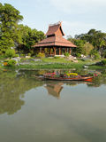 Thai pavilion and flower boat Royalty Free Stock Images