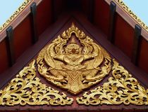 Thai pavilion. Gold art on Thai pavilion roof royalty free stock images