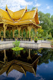 Thai Pavilion (sala) Reflected. A beautiful thai pavilion or sala in madison wisconsin sent as a gift from thailand reflected in a pool Stock Image