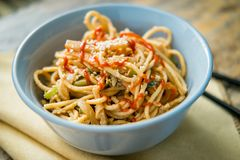 Thai Peanut Butter Lo Mein. Spicy Thai vegetable peanut butter lo mein noodles with sesame seeds stock photography