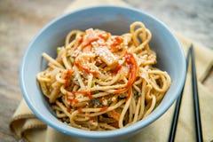 Thai Peanut Butter Lo Mein. Spicy Thai vegetable peanut butter lo mein noodles with sesame seeds stock photos