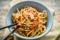 Thai Peanut Butter Lo Mein. Spicy Thai vegetable peanut butter lo mein noodles with sesame seeds royalty free stock photo