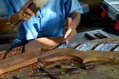 Thai people carving traditional thai art wood figure. For show traveller Stock Image