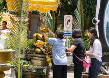 Thai people celebrate Songkran Festival by pouring water over Buddha statue to signify cleansing for the new year. KHONKAEN, THAILAND - APRIL 13, 2017 : Thai royalty free stock photo