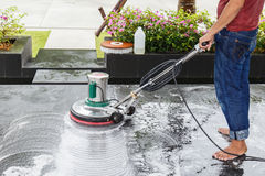 Thai people cleaning black granite floor with machine and chemic Stock Images