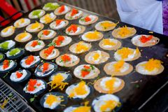 Called Thai sweetmeat Khanom bueang. Thai people cooking ancient Indigenous called Thai sweetmeat Khanom bueang a kind of filled pancake at street market Stock Photos