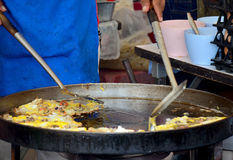 Thai people cooking Fried mussel with egg and crispy flour Stock Images