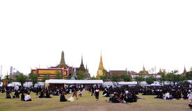 Thai people dressed in black as they sit and wait in line to offer condolences for Thailand`s late King Bhumibol Adulyadej Stock Images