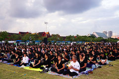 Thai people dressed in black as they sit and wait in line to offer condolences for Thailand`s late King Bhumibol Adulyadej Stock Photo