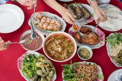 Thai people eating local thai food together. Group of Thai people enjoying eating local thai food together. Top view of Hand having dinner and share food stock image