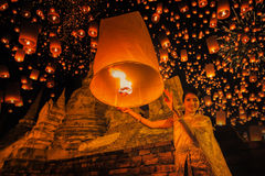 Thai people floating lamp in Ayuthaya historical park. With Wat Phra Sri Sanphet temple background, Thailand stock image