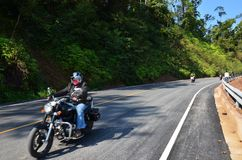 Thai people and foreigner traveler riding motorcycle on the road royalty free stock photography