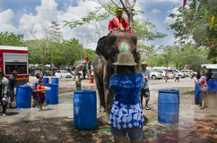 Thai people and foreigner travelers playing and splashing water with elephants and people in Songkran Festival at Ayutthaya. City on April 14, 2017 in Ayutthaya royalty free stock photo